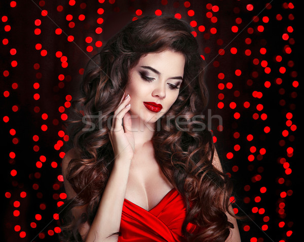 Red lips makeup. Beautiful Brunette girl with long healthy curly Stock photo © Victoria_Andreas
