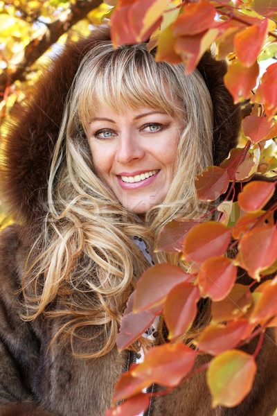 Portrait of pretty cheerful middle aged blonde woman over autumn Stock photo © Victoria_Andreas