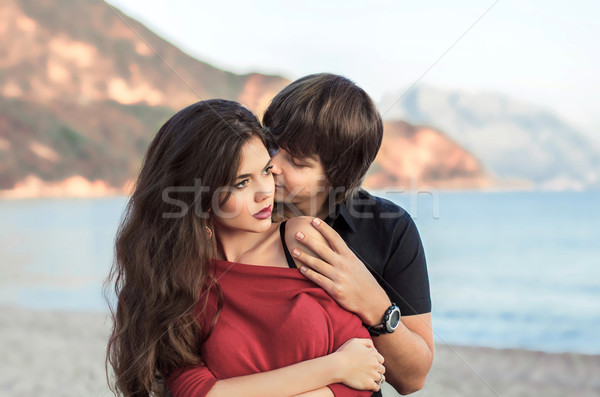 Romantic couple in love at beach sunset. Newlywed happy young lo Stock photo © Victoria_Andreas
