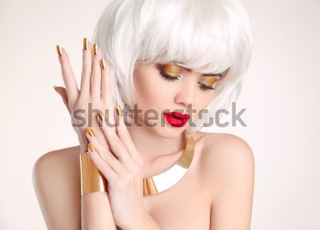 Red lips and manicured nails. Fashion Stylish Beauty Woman Portr Stock photo © Victoria_Andreas