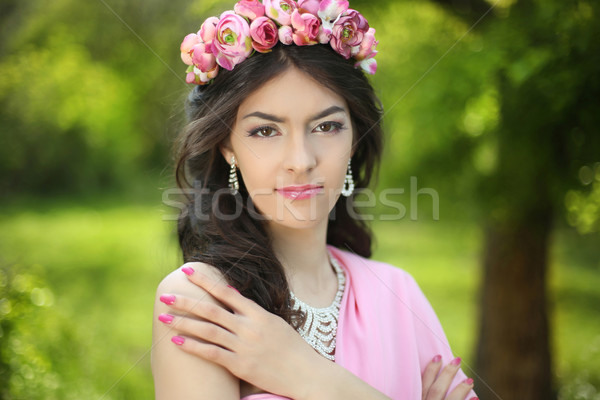 Brunette girl with flower chaplet in green filed wearing in pink Stock photo © Victoria_Andreas