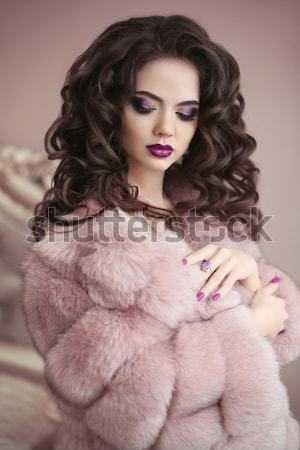 Young brunette woman model with long flying hair in pink fur coa Stock photo © Victoria_Andreas