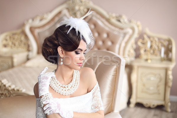 Retro woman portrait. Elegant brunette lady with hairstyle, pear Stock photo © Victoria_Andreas