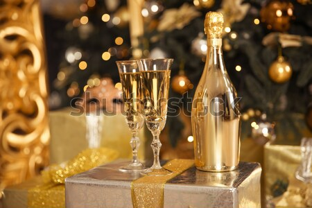 Two champagne glasses with golden bottle ready to bring in the N Stock photo © Victoria_Andreas