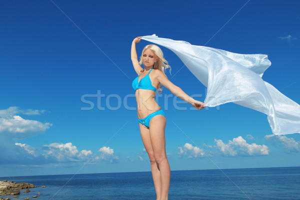 Beautiful young woman opened her hands with delight at the blue  Stock photo © Victoria_Andreas