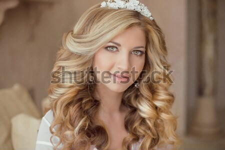 Long curly hair. Beautiful blond happy smiling bride girl lookin Stock photo © Victoria_Andreas