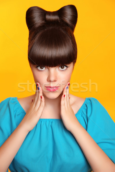 Surprised smiling teen girl with bow hairstyle, makeup and colou Stock photo © Victoria_Andreas