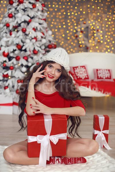 Christmas girl portrait in winter hat. Beautiful santa woman pre Stock photo © Victoria_Andreas