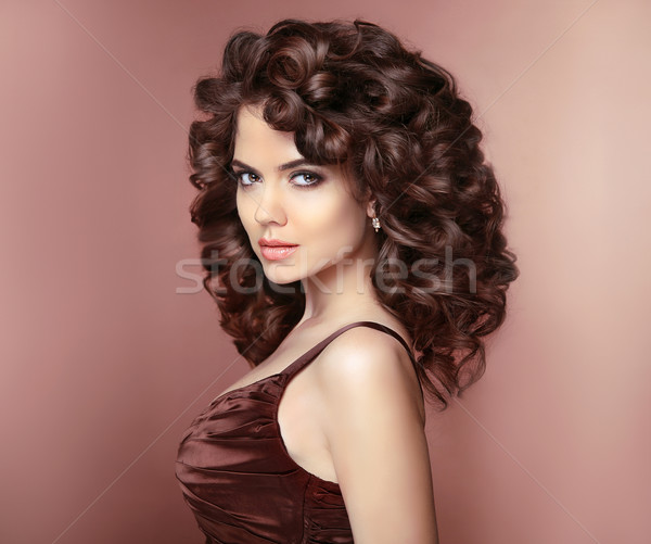 Healthy hair. Beautiful young smiling woman with long curly hair Stock photo © Victoria_Andreas