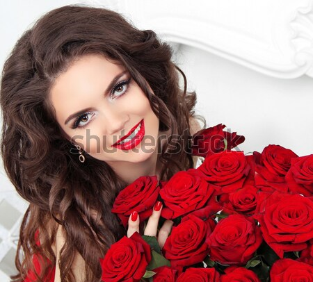 Portrait of beautiful brunette woman holding red rose Stock photo © Victoria_Andreas
