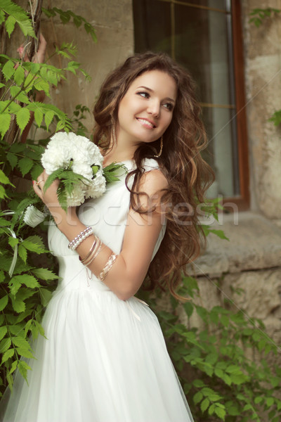 Outdoor Portrait Of Beautiful Happy Bride with long wavy hair in Stock photo © Victoria_Andreas