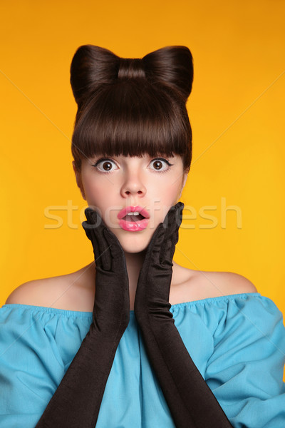 Surprised Young funny girl with bow hairstyle isolated on yellow Stock photo © Victoria_Andreas