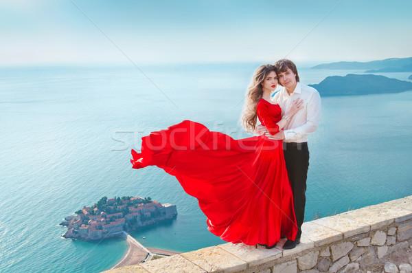 Romantic young couple in love over blue sea shore background. Fa Stock photo © Victoria_Andreas