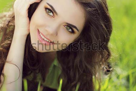 Close portrait of beautiful young woman on green grass in the su Stock photo © Victoria_Andreas