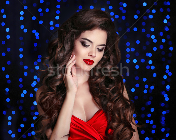 Beautiful brunette woman studio portrait. Elegant lady with red  Stock photo © Victoria_Andreas
