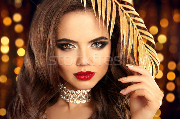 Beauty fashion brunette portrait in gold. Sexy elegant woman wit Stock photo © Victoria_Andreas