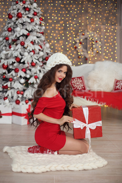Christmas girl portrait in winter hat. Beautiful santa woman pre Stock photo © Victoria_Andreas