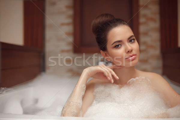 Skincare. Wellness. Young woman relaxing in jacuzzi bath spa, br Stock photo © Victoria_Andreas