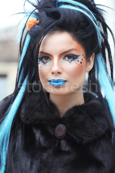 Portrait of young beautiful punk dark girl over urban landscape. Stock photo © Victoria_Andreas