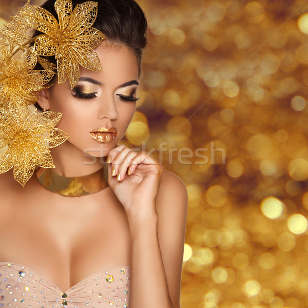 Fashion Beauty Girl portrait with flowers Isolated on golden bok Stock photo © Victoria_Andreas