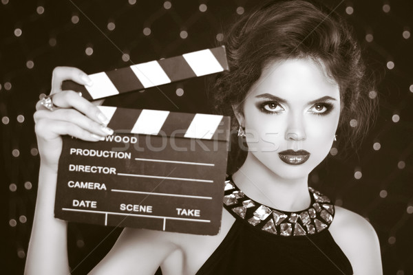 Retro casting tests, woman holding cinema clap. Super star model Stock photo © Victoria_Andreas