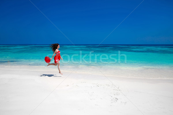 Beautiful free young woman jumping on the exotic sea, happy brun Stock photo © Victoria_Andreas