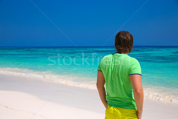 back view of happy man enjoying good life on exotic beach, guy l Stock photo © Victoria_Andreas