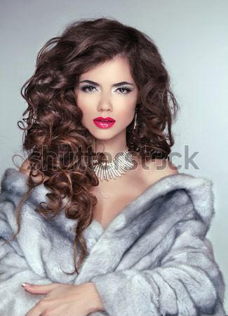 Woman with beauty long brown hair - posing at home studio Stock photo © Victoria_Andreas