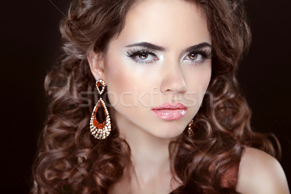 Long hair. Beautiful brunette girl model with fashion earrings.  Stock photo © Victoria_Andreas