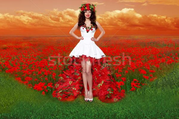 Outdoors portrait of Beautiful young woman wearing in red rose d Stock photo © Victoria_Andreas