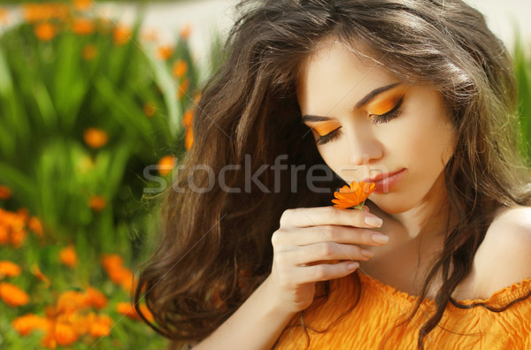 Outdoors portrait of Beautiful Teen girl smelling flower, over m Stock photo © Victoria_Andreas