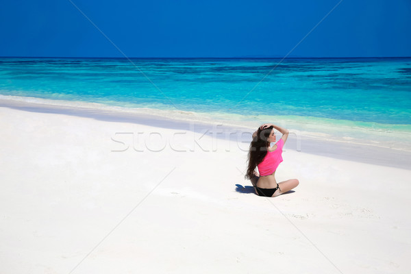 Enjoying life. Healthy free woman walking on exotic sea. Fit bru Stock photo © Victoria_Andreas