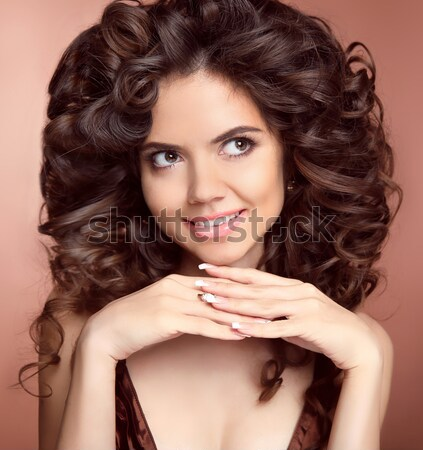 Beautiful smiling brunette girl with long curly hairstyle. Happy Stock photo © Victoria_Andreas