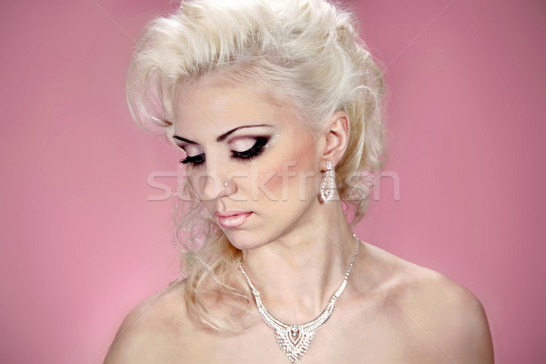 Beautiful woman with evening make-up. Jewelry and Beauty. Fashio Stock photo © Victoria_Andreas