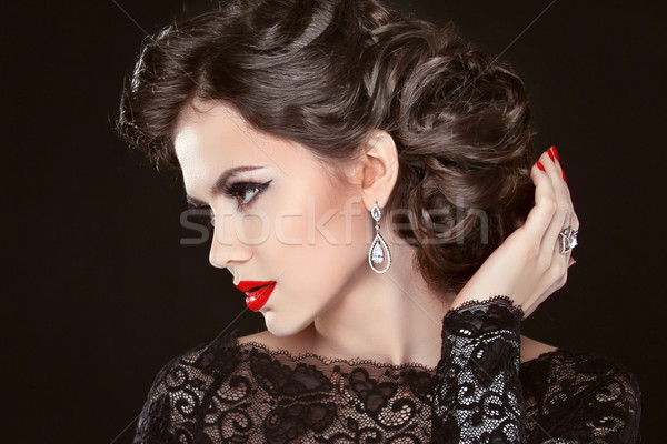Beautiful elegant girl model with jewelry, makeup and retro hair Stock photo © Victoria_Andreas