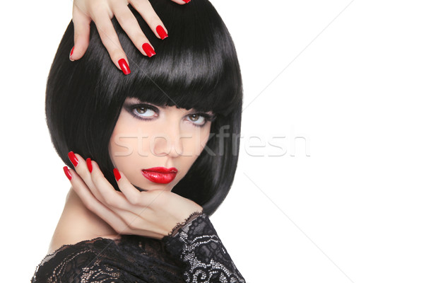Manicured nails. Beauty girl portrait. Red lips. Back short bob  Stock photo © Victoria_Andreas