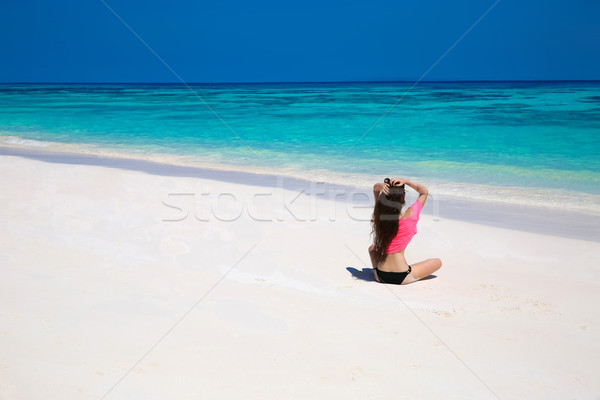Happy brunette woman enjoying on exotic beach in summer by tropi Stock photo © Victoria_Andreas