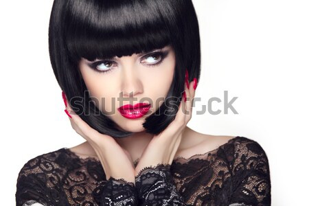 Makeup. Manicured nails. Beauty girl portrait. Red lips. Back sh Stock photo © Victoria_Andreas