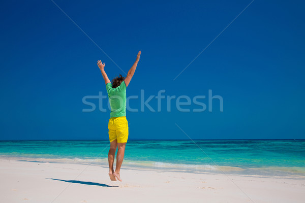 Freedom Beach Summer Holiday Concept. Handsome young man jumping Stock photo © Victoria_Andreas