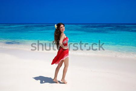 Beautiful smiling girl running on exotic beach with white sand a Stock photo © Victoria_Andreas