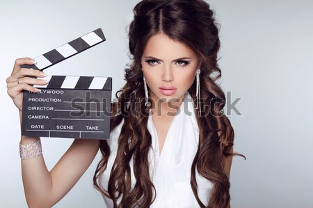 Fashion elegant woman posing with sexy red lips holding cinema c Stock photo © Victoria_Andreas