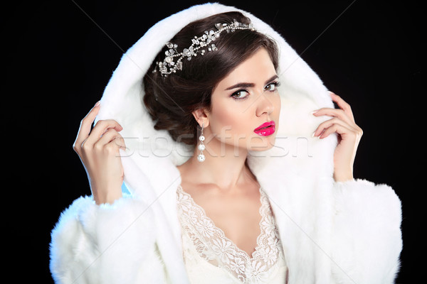 Wedding hairstyle. Winter Girl in fashion Fur Coat. Makeup. Luxu Stock photo © Victoria_Andreas