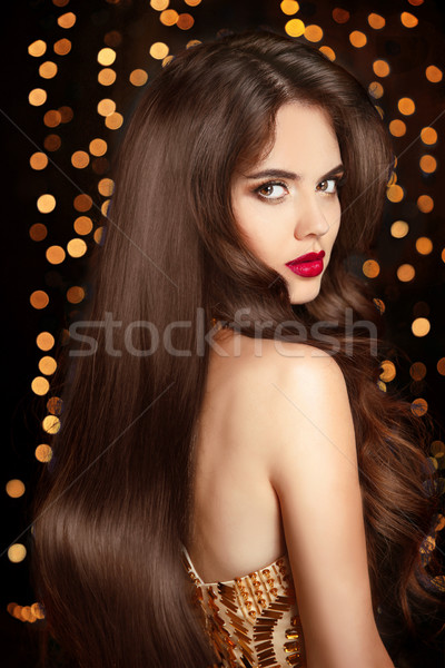 Healthy hair. Makeup. Beautiful brunette girl with long wavy hai Stock photo © Victoria_Andreas