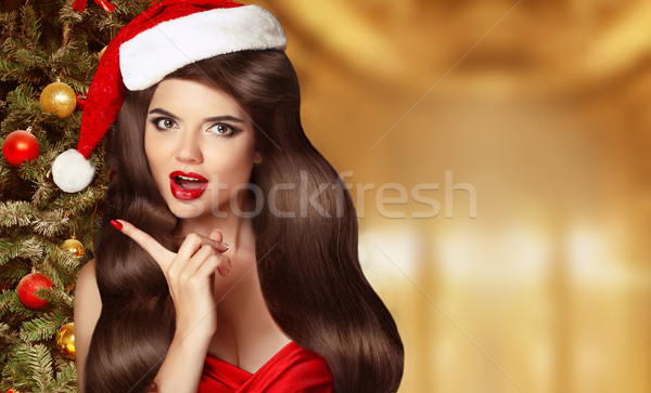 Stock photo: Surprised Woman showing finger pointing to the side. Beautiful g