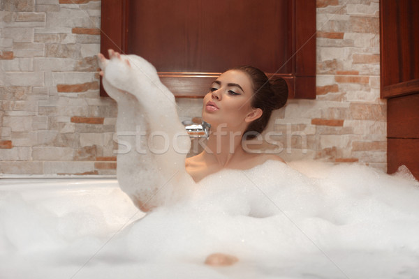 Stock photo: Beautiful Young woman relaxing in jacuzzi bath spa, Attractive g