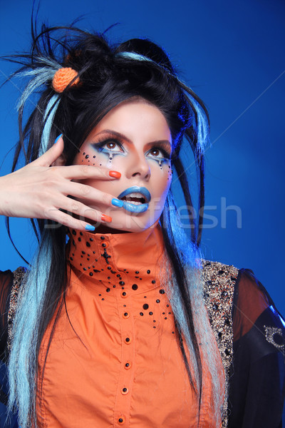 Nails Manicured. Make up. Close up of woman face with colorful m Stock photo © Victoria_Andreas