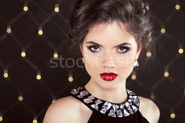Stare. Elegant brunette woman lady with makeup and hairstyle. Fa Stock photo © Victoria_Andreas