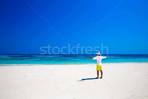 Seashore. Happy free Man on summer vacation Raising Hands or Ope Stock photo © Victoria_Andreas