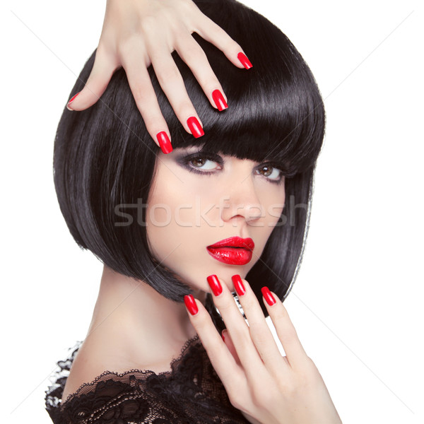 Beauty fashion brunette model portrait. Manicured nails. Red lip Stock photo © Victoria_Andreas