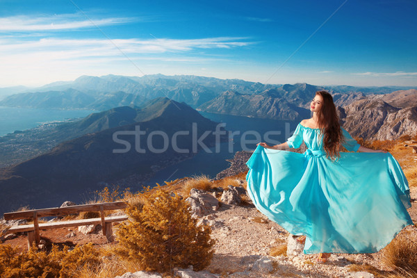 Montenegro landscape above Kotor bay. Beautiful woman in blowing Stock photo © Victoria_Andreas